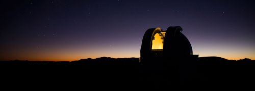 (picture of McDonald Observatory at night)